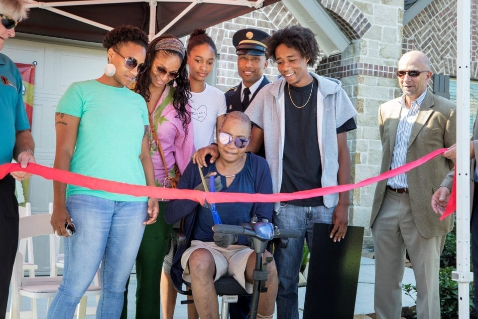 Ribbon cutting for an Operation Finally Home project