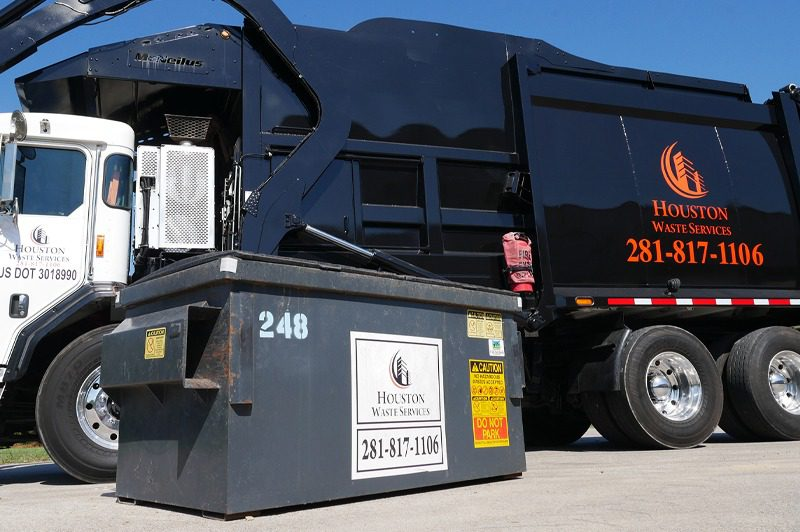 Houston waste service dump truck and waste container