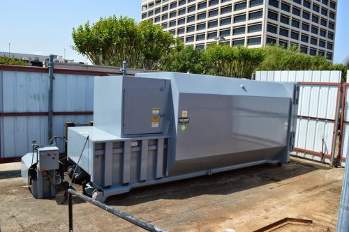 Self-contained waste compactor